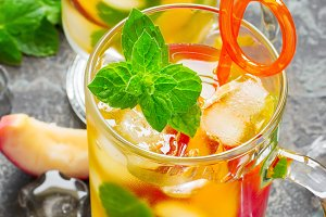 refreshing summer drink Peach Sweet Tea with ice and mint