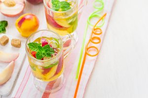refreshing summer drink Peach Sweet Tea with ice and mint, Top v