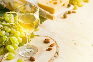 White wine in a glass on a white background, tinted, copy space