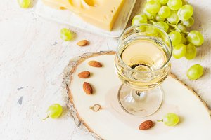 Glass of white wine and grapes, copy space