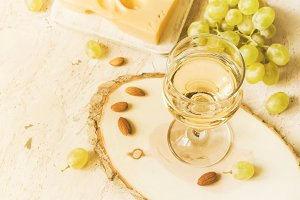 Glass of white wine and grapes, copy space, tinted