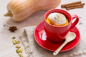 Autumn dessert of pumpkin baked in a cup, space for text