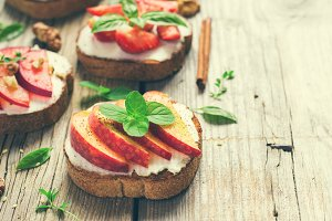 Summer breakfast bruschetta with peaches, plums, strawberries an