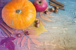Vintage background with pumpkin, nuts and leaves.