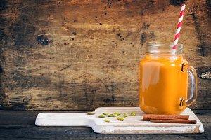 Healthy pumpkin smoothie with cinnamon and pumpkin seeds