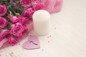 Valentine's day concept with heart, candle and roses
