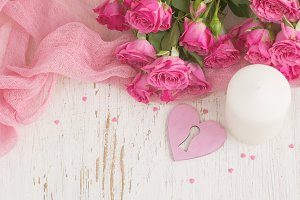 Valentine's day background with heart, candle and roses. Top vie
