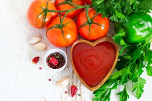 Tomato ketchup sauce with spices and herbs in wooden bowl, Top v