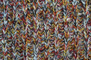 Knitted woolen fabric of colored yarn