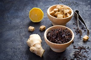 Ingredients for sweet tea with lemon and ginger. copy space