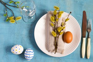 Spring Easter Table setting on a wooden table. Top view.