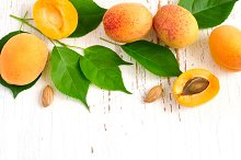 White background with ripe apricots. Top view with copy space