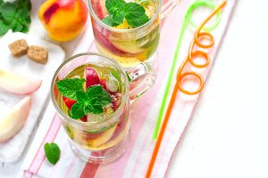 Cold peach tea with mint. Refreshing summer drink. Top view with