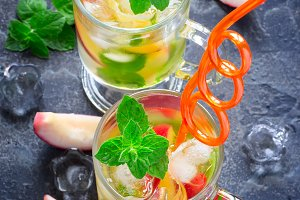 Cold peach tea with mint. Refreshing summer drink
