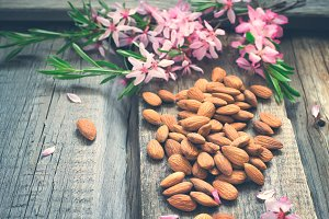 Spring background with flowers and almond nuts, tinted