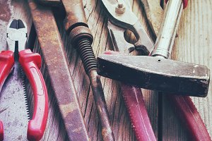 Background of old rusty tools. Tinted.