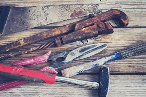 Set of old tools: hammer, saw, chisel, metal shears, wire cutter
