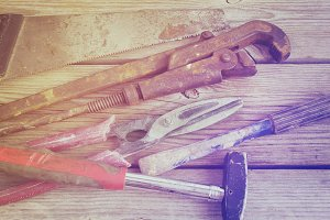 Background with old tools: hammer, saw, chisel, metal shears, wi