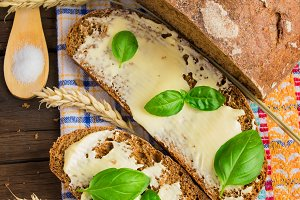 Slices of bread with butter and herbs