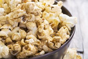 Sweet caramel popcorn in a  bowl, selective focus