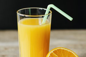 orange juice with straw