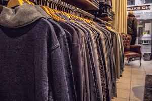 Sweaters on a Rack