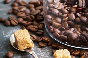Coffee beans and brown sugar on a vintage background
