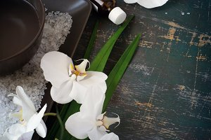 SPA setting with blooming white orchids and sea salt.