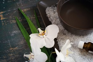 SPA setting and blooming white orchid. Space for text. Top view