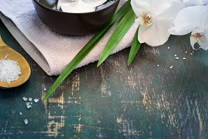 Spa background with white orchid. Space for text