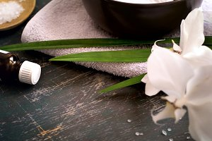 Spa background with white orchid in bowl of water. Space for tex