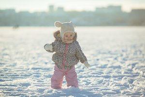 little girl walks in the snow