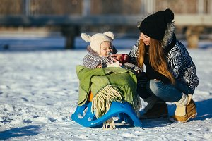 mother and daughter in winter outdoors