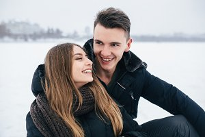 couple sitting on the snow