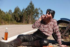 Crazy biker smoking a cigar