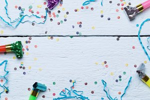 Penny whistles, festive confetti ,photo