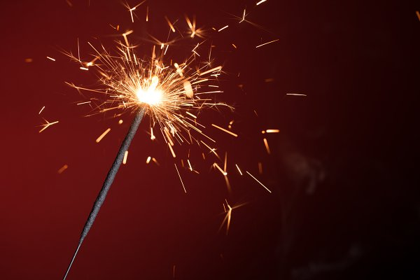 Christmas sparkler on red backgroun…
