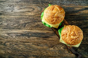 Hamburger on a wooden board, presentation.