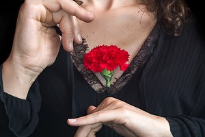 Andalusian woman holding a carnation