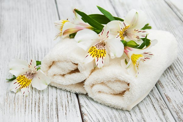 Health Stock Photos: Almaje - Spa towels and alstroemeria flowers