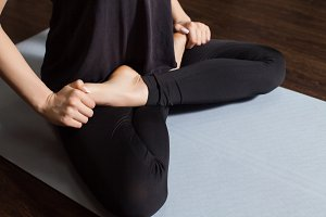 woman  is in yoga pose.