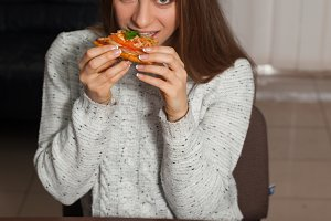 woman keeps delicious pizza