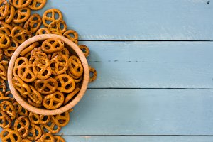 Pretzels on blue wooden background