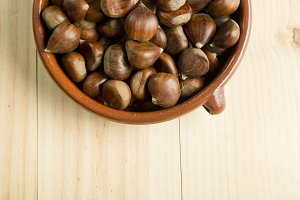 Chestnuts in an earthenware bowl.