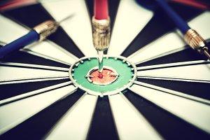 Dart arrow hitting in the target