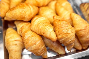 Fresh croissants in plate