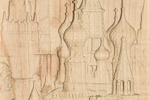 Woodcarving. Carved relief image of the Moscow Kremlin on a wooden plank