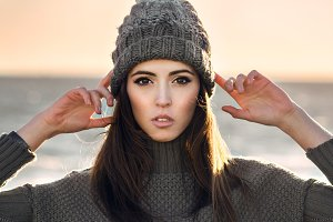 woman wear knitted hat and sweater