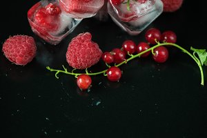 Frozen berries on wooden table