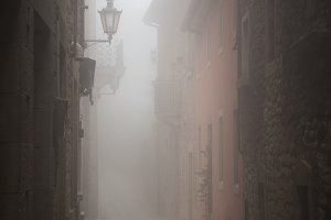 Narrow street of San Marino during foggy weather